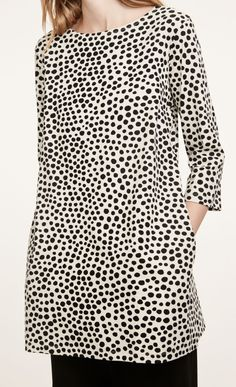 Made out of cotton jersey, the Peretta tunic in a clay and black Iso Pirput Parput pattern has three-quarter sleeves, a boat neckline, side seam pockets and a slightly widening A-line cut to the above-knee hemline. Marimekko, Black Dots, Hemline, My Style, How To Wear, Cotton, Fashion Design, Shirts, Clay