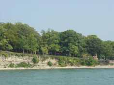 South Bass Island State Park : Put-in-Bay, Ohio =  Perched atop the white cliffs of South Bass Island, this unique 33-acre park is a scenic landmark when viewed from the water, and in turn affords visitors great views and access to Lake Erie • The wooded campground and serene lakeside picnic area offer a quiet retreat from the bustle of Put-In-Bay • South Bass Island's companion park, Oak Point, offers facilities for boaters and picnickers close to the heart of town