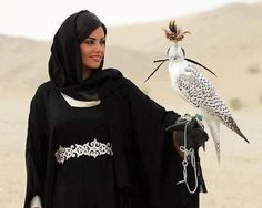 arab woman with a Falcon