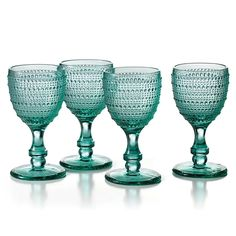 The versatile and intriguing Teal Bead Glass Goblet Set is crafted from durable blue tinted glass with ornate beadwork throughout. This set coordinates well with formal and casual dinnerware. Teal Dinnerware, Casual Dinnerware, Vintage Wine Glasses, Turquoise Pattern, Dining Room Table Decor, Mug Cozy, Fenton Glass, Blue Quilts, Bohemian Living