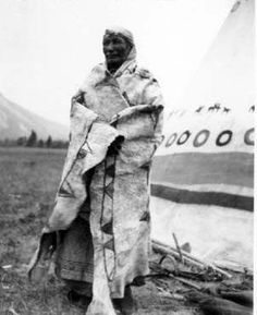 Assiniboine woman with painted Buffalo robe - circa 1925