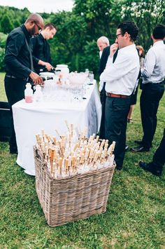 Get a drink and pick up a paper parasol! Thoughtful touch for an outdoor wedding.