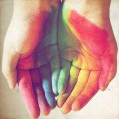 Rainbow reflection on hands