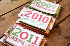 i like the idea of keeping every year's christmas cards in a little book