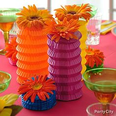 Paper lanterns + daisies = pretty *pineapple* centerpiece for a luau party!