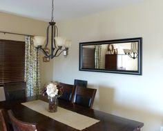 Beautiful Oil Rubbed Black Iron 5 Light Dining Chandelier Over Dark Wood  Long Dining Table And · Dining Room MirrorsBlack ...
