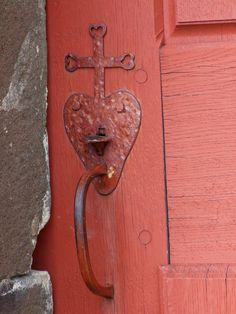 Red heart lock with cross on exterior door - Brittany, France