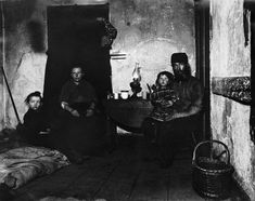 1888 — In Poverty Gap, West 28 Street: an English Coal-Herver's Home — Photo by Jacob Riis, Image © Bettmann/Corbis