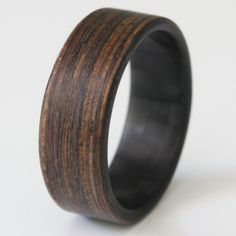 Bridging the gap between old world and new. Stronger and more durable than an all wood ring, this ring will not let you down.
