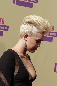Miley Cyrus flaunts an edgy mohawk and a plunging neckline at the MTV Music Video Awards 2012
