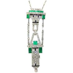 Art Deco pendant; diamonds, emeralds and onyx by Verger Freres.