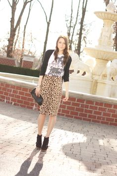 Leopard skirt with a graphic tee with booties & a cardigan. Print combo.
