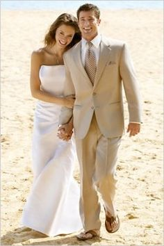 Formal Wedding Attire  Some beach weddings still find the bride and groom dressed to impress. But instead of wearing that formal black tuxedo, why not a sand-colored suit with a tie? Pair the suit with sandals instead of dress shoes for an added touch of comfort on the beach.