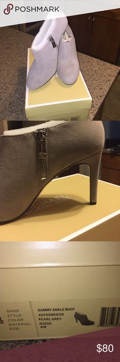 """Michael Kors """"Sammy Ankle Boot"""" size 8 Brand new, never worn Michael Kors ankle boot in pearl grey suede material. Very small spot on the front of the left shoe but it is close to the sole and would be difficult to see. Michael Kors Shoes Heeled Boots"""
