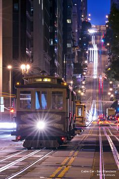 Cable Car - San Francisco A different perspective to see the cable cars at night on California street. San Francisco At Night, San Francisco Cable Car, San Francisco California, California Usa, Places Around The World, Around The Worlds, New York Photography, Food Photography, Unique Buildings