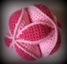 Amish Puzzle Ball--11 Crochet Amish Puzzle Ball Pattern.  Okay, so it's for babies, but I so think I would have fun with this!  And, it would be a unique gift.
