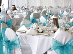 ..white seat covers w/aqua blue organza-tulle tie-backs and white table clothes