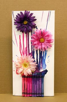 Adorable kid art idea using crayons, paint and faux flowers