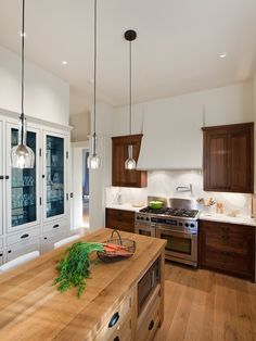 Cottage Kitchen Features A Pair Of The Urban Electric Co Chisholm Hall  Lanterns Illuminating A Center Island Topped With Grey And White Marble U2026