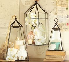 coastal traveler style tablescape vignette with lanterns and maps