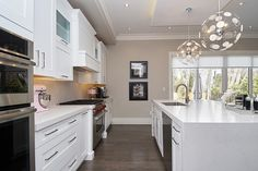 Large transitional kitchen, with white shaker doors, waterfall island, custom hood cabinet, pilasters at stove. Transitional Kitchen, Transitional Style, Modern Kitchen Design, Modern Design, Waterfall Island, Shaker Doors, Kitchen Styling, Kitchen Inspiration, Stove
