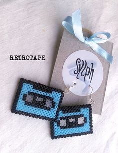 Pixelated baby blue Retrotape cassette earrings by SylphDesigns