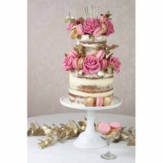 This semi naked wedding cake is the perfect combination pretty and glamorous. The gold gives it the high-end look all brides want, whilst the pink and cream add the chic prettiness that is so wedding-perfect. We love the addition of macarons, gold leaves and pink roses – we wouldn't change a thing if we could.