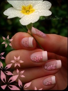 Standard French Manicure white tips with pink floral flower decals. Clear crystal accents