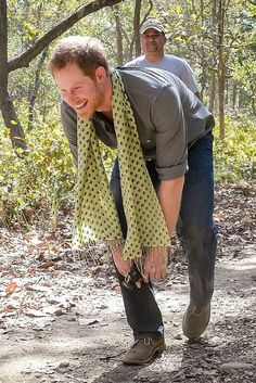 Prince Harry earns his stripes by pretending to be a tiger on visit to Nepal