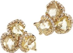 Rough diamonds set amongst brilliant cut diamonds.  Raw beauty with a bit of sparkle!