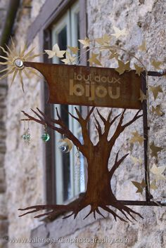 Photo Essay – Quaint French Shop Signs This jewelry artist displays her work on her sign. Storefront Signage, Shop Signage, Pub Signs, Sign Display, Shop Fronts, Store Signs, Advertising Signs, Photo Essay, Hanging Signs