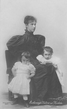 Marie Valerie and her children Franz Karl and Elisabeth Franzisca |This is middle-1890s leg-o-mutton style. Her waistline and arms cannot be seen..  Marie Valerie's sleeves date this to the middle 1890s, Elisabeth Franziska was born in 1892, Franz Karl in 1893, Hubert Salvator in 1894 while Hedwig was born in 1896, giving a wide interval in the middle 1890s where Marie Valerie could be photographed.