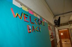 """Creative """"Welcome Back"""" bulletin board: Peeled crayons hot-glued onto colorful bulletin board paper!"""