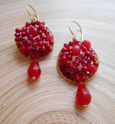 With a vibrant, juicy pomegranate-like tone and stunning presence, Grenade is a pair of earrings you will reach for time and time again. I hand formed and hammered a round hoop frame out of gold filled wire and inside it I wire wrapped cherry red agate faceted rondelles, scarlet red