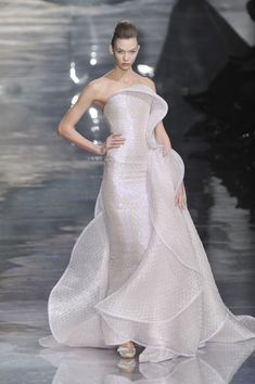 Who wore Armani Privé's extravagant opal ruffle gown?
