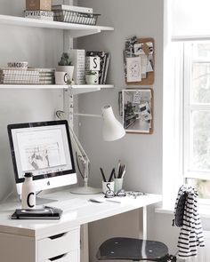 White desk of Cate St Hill.
