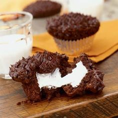 What a shame that Greg hates marshmellow!  Boo.    Crazy for Cupcakes  | Devil's Food Cupcakes with Marshmallow Filling | MyRecipes.com