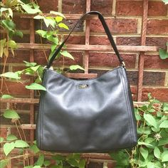 NWT Kate Spade Bria Highland Bag New with tags: Soft black leather with a bright pink silk interior lining. A perfect bag for work or going out. A wardrobe staple!! kate spade Bags Shoulder Bags