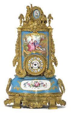 A Louis XVI style gilt bronze mounted porcelain mantel clock late 19th century