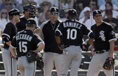 Chicago White Sox manager Robin Ventura, center, talks with his infield during a pitching change in the sixth inning of a spring training baseball game