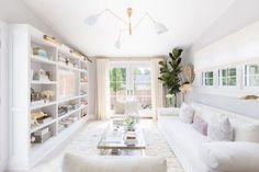 BECKI OWENS-- Dream Home: A Fresh, Feminine Coastal. See this Cape Cod beauty with white shiplap, natural light, open floor plan, gold accents, lucite hardware, and pretty textiles.