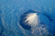 Mount Fuji, 100 kilometres south-west of Tokyo in Japan, rises out of the cloud covering the surrounding area.