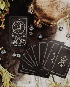 A black and gold foil tarot deck. Printed on black plastic and independently published. Comes with companion tarot apps for tarot readings tarot meanings and more on the go. For all lovers of magic witchcraft wicca paganism mysticism and more. Dark tarot deck unique tarot deck indie tarot deck. #tarotcardsforbeginners #tarotcardsmeaning