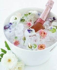 Ice cubes with flowers...coolest idea ever!! I want to get married again!! Even just for the bride and grooms bottle! Omg!