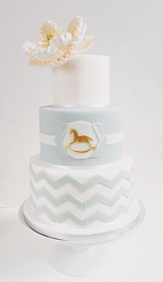 Rocking Horse themed chevron baby shower cake by Catisserie, Toronto.   Three tier aqua and white cake with a pink  sugar peony.