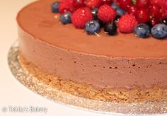 dark chocolate mousse cake with berryes