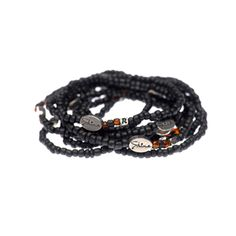 This Stack Of 10 Mens Bracelets Has A Glint Light Accent Beads Signifying The Sense