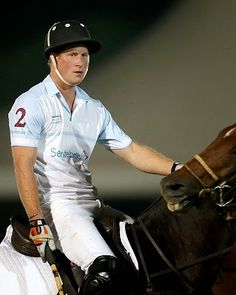 Prince Harry plays during the Sentebale World Polo Cup 2014 at Ghantoot Polo Club in Abu Dhabi, UAE