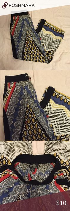Comfy Printed Pants Soft and comfy wide leg printed pants. Elastic waist with adjustable tie. Size medium but fit me and I am a small Angie Pants Wide Leg