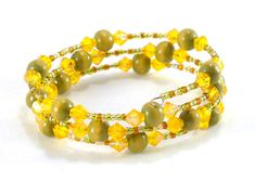 Green, yellow and orange memory wire wooden beaded bracelet by TheBeadedCatsEye